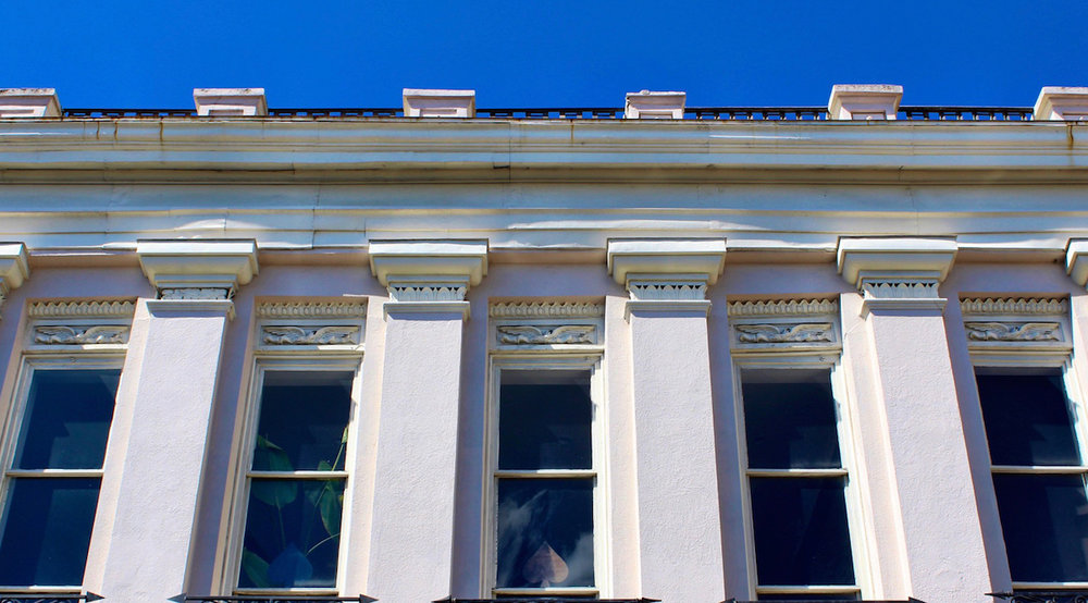 321 King Street - This cornice has a balustrade on top.