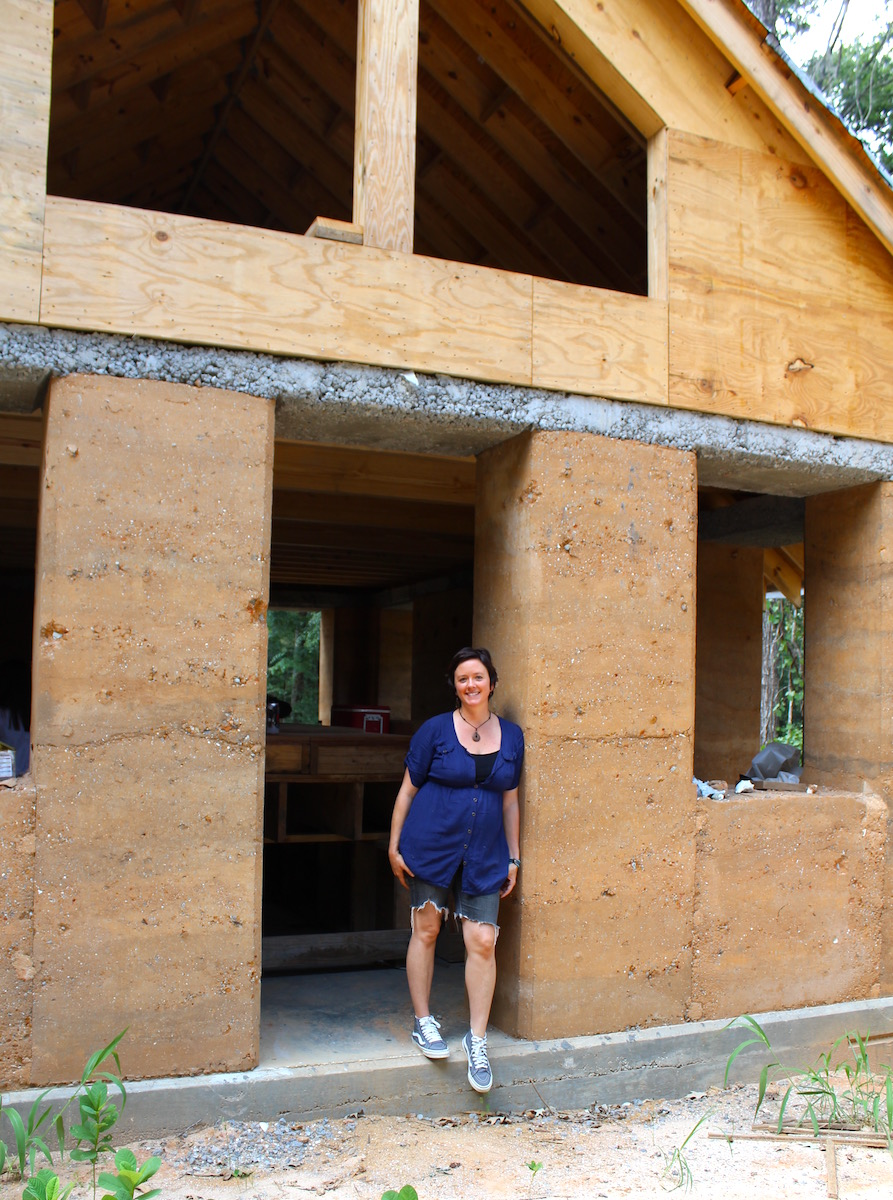 Architect April Magill standing in the doorway of the Walters Residence currently under construction.  This house is the first rammed earth building in Charleston.  Photo Credit:  Danielle Ramos