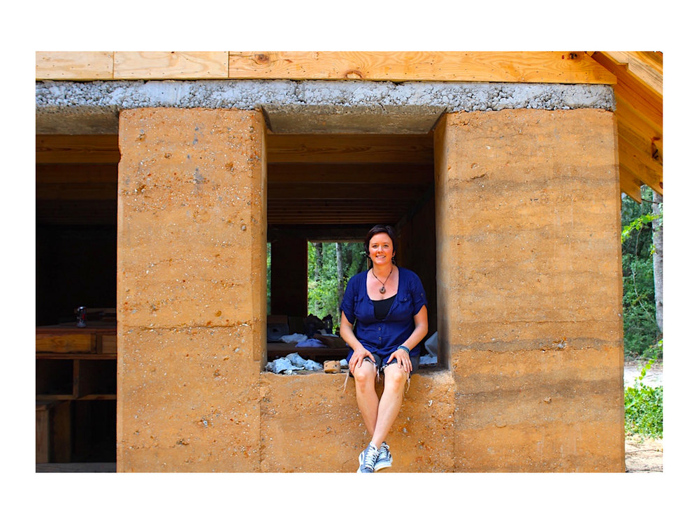 Architect April Magill of Root Down Designs.  Sitting in the window sill of Charleston's first Rammed Earth House:  The Walters Residence.  Photo Credit:  Danielle Ramos