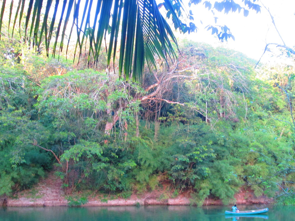 Belize River with Canoe.JPG