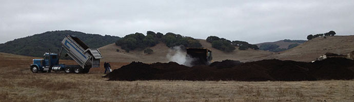 Above:   Ranchers in Marin County, CA  applying compost at their cattle ranching operation. Scientists at UC Berkeley are working with these ranchers to understand the carbon removal potential of compost application on ranches.