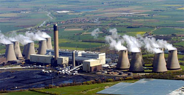 "Coal power plants like the one above ""spill"" billions of tons of carbon dioxide gas into the atmosphere each year. Even though this volume dwarfs the amount of oil spilled each year, our response to oil spills is much more aggressive than our response to carbon emissions. Image credit:  the Guardian"