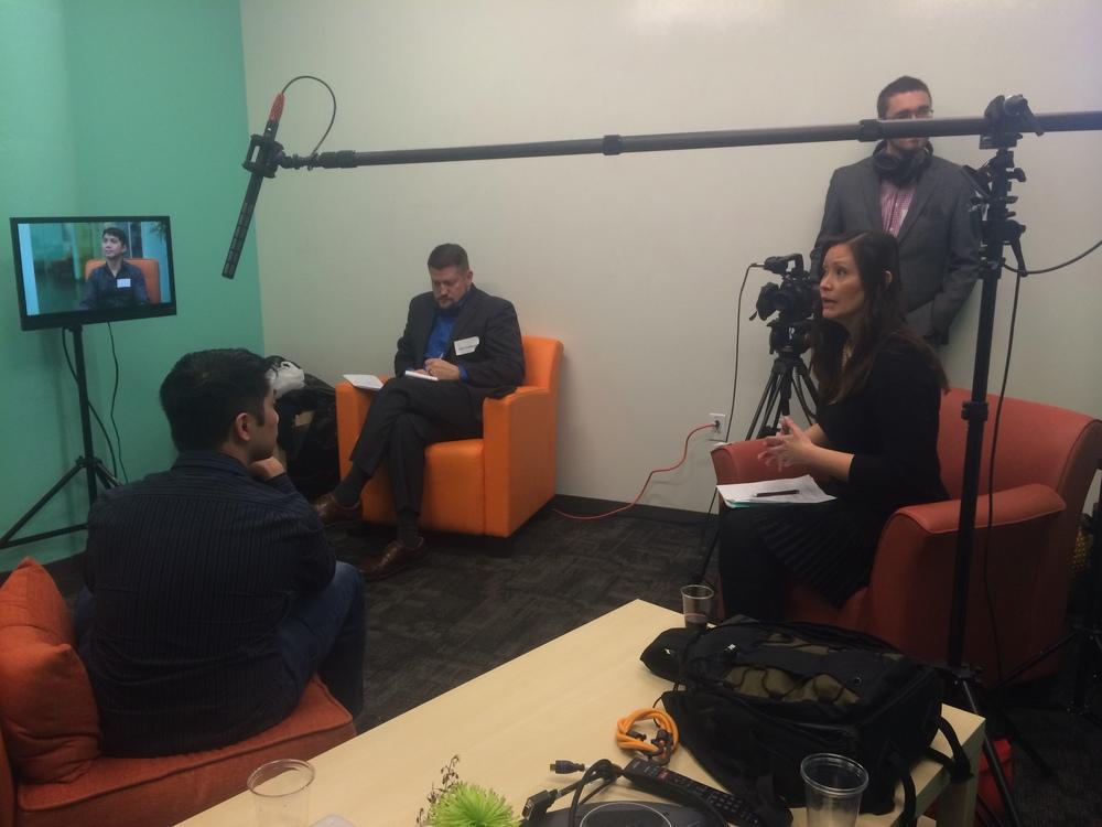 Sonja Shin giving interview feedback at her Venture Cafe workshop.