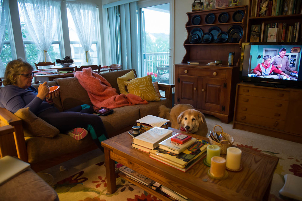 Joani Peacock eats while watching television after returning from her daily walk, at her home in Alexandria, Va., Friday, Oct. 3, 2014. Peacock, who is bipolar, walks regularly and is training to walk a half marathon because she says regular exercise helps her feel more balanced.