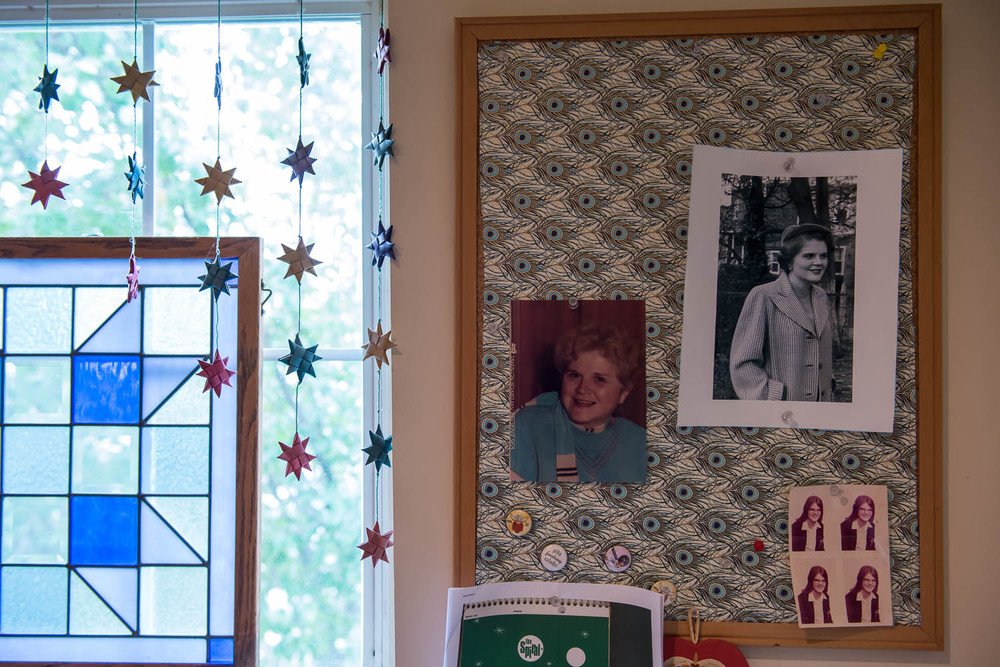A bulletin board displays two photos of Joani Peacock's mother, Mary Louise Cady Peacock (top left and right), and four wallet-sized photos of Joani Peacock taken in the early 1970s (bottom right), in Peacock's Alexandria, Va., home Wednesday, Sept. 24, 2014. Peacock, like her mother, has been diagnosed with bipolar disorder, a brain disorder that is believed to be genetic and tends to run in families.