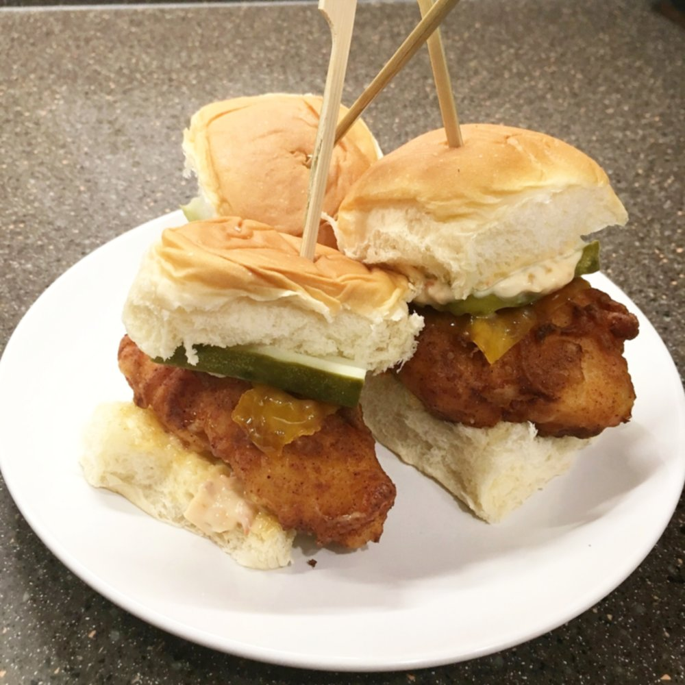 Sous-vide fried chicken sliders with cheddar cheese,  pickles, and french onion aioli
