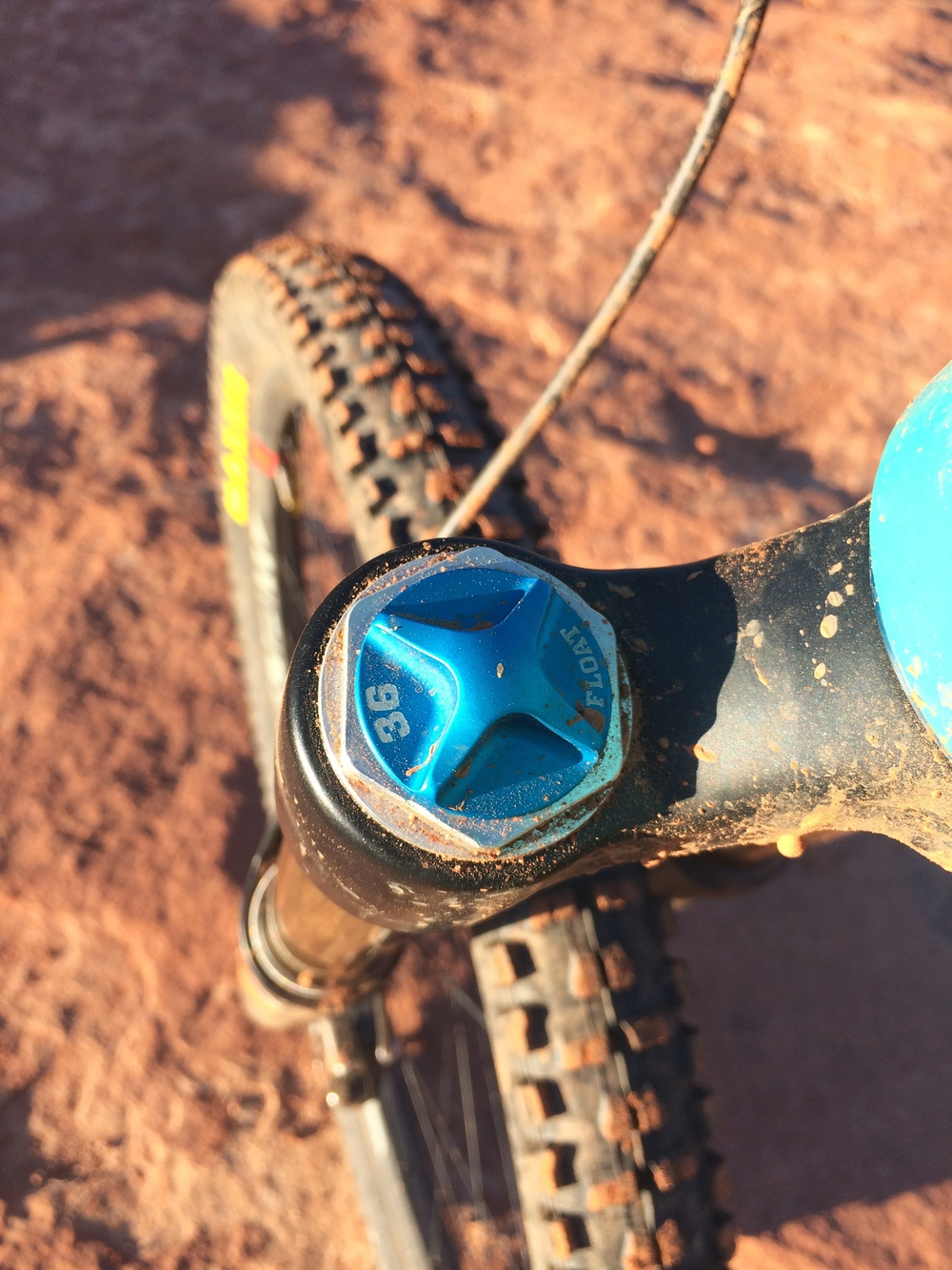 The air pressure in your fork can be adjusted with a shock pump by unscrewing a cap on the top of the fork's crown.