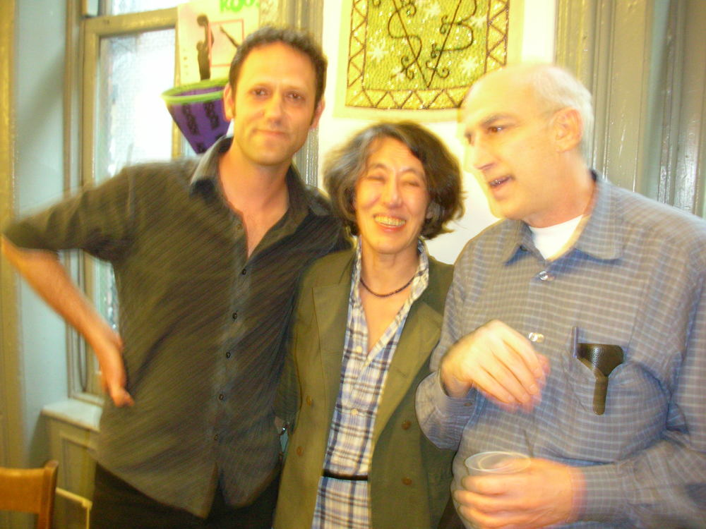 "Jonathan Skinner & Mei-mei Berssenbrugge with host James Sherry at the ""Eco-Poetics"" Reading after-party.  LH"