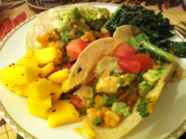 Pumpkin Tacos with Mango and Kale   Feeds: 4   Time: 40 minutes   I love pumpkin and tacos so figure why not combine the two. The colors and flavors are so rich and tasty you'll be asking for seconds.    Ingredients: ½ sugar pumpkin 1 tsp fresh ginger ½ tsp of cinnamon ½ tsp of cumin powder 1 tsp agave (optional) — ½ diced yellow onion 5 diced garlic cloves 1 jalapeno (add another if you like it spicy) 2 tsp cumin powder 16oz. frozen chopped mixed vegetables (corn, peas & carrots) safflower oil or macademia nut oil (best for high heat) handful of chopped cilantro ½ fresh squeezed lemon white corn tortillas sea salt   Taco Toppings: steamed kale with garlic mango with dulse flakes avocado with sea salt goat cheese crumble  2 diced tomato   How to make Pumpkin Tacos?   Step 1: Preheat oven to 375 degrees. Cut ½ the pumpkin into cubes removing the pulp and seeds. Rub oil and sea salt on it and place onto a pan and into the oven for 30 minutes (or more) until the pumpkin is nice and tender.   Step 2:  While the pumpkin is cooking go ahead and dice up the onion, garlic and jalapeno(s). Once you've done that, get a pan, add some oil and on medium heat add in the garlic. Watch and stir the garlic for about 30 seconds. Add in the onions and jalapeno and stir-fry it for about a minute. Now, you can add in the frozen vegetables (corn, peas & carrots) to the mix with the cumin powder and salt. Watch and stir for about 15 minutes and then add in some cilantro and fresh squeezed lemon juice. I like to wait until the end to add in a few diced tomatoes, so the veggies do not become watery. Once the pumpkin is cooked. Take off the rind. Now, stir-fry the pumpkin on medium heat in some oil with ginger, cinnamon and cumin powder. If the pumpkin needs it then add in a little agave to sweeten it up.   Step 3: Warm up the tortillas by getting a pan. Add some oil and then flip the tortillas on high to medium heat until they are cooked the way you like it.   Step 4: Add the veggies and pumpkin into the tortilla and some goat cheese crumble. Then you have the luxury to add in any toppings you like to. We added avocado, mango, tomatoes and steamed kale. to make a tasty massive taco. The colors and flavors remind me of California.   Enjoy!