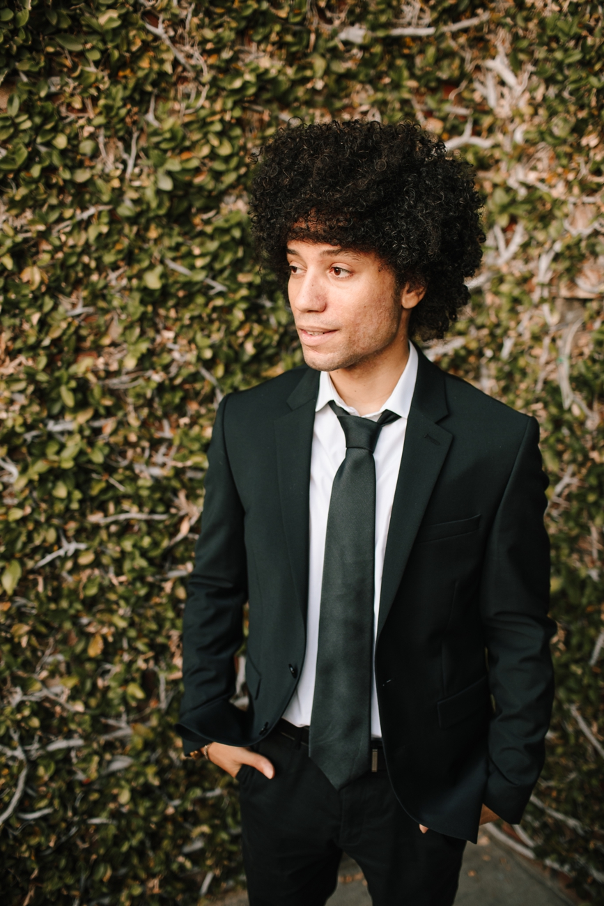 Groom with natural afro hair in suit casual wear for wedding in Los Angeles estate