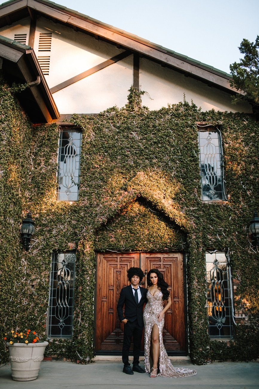 Black and hispanic couple at their engagement session in elegant formal gown and suit at Humphrey's Estate in Temecula Wine Country