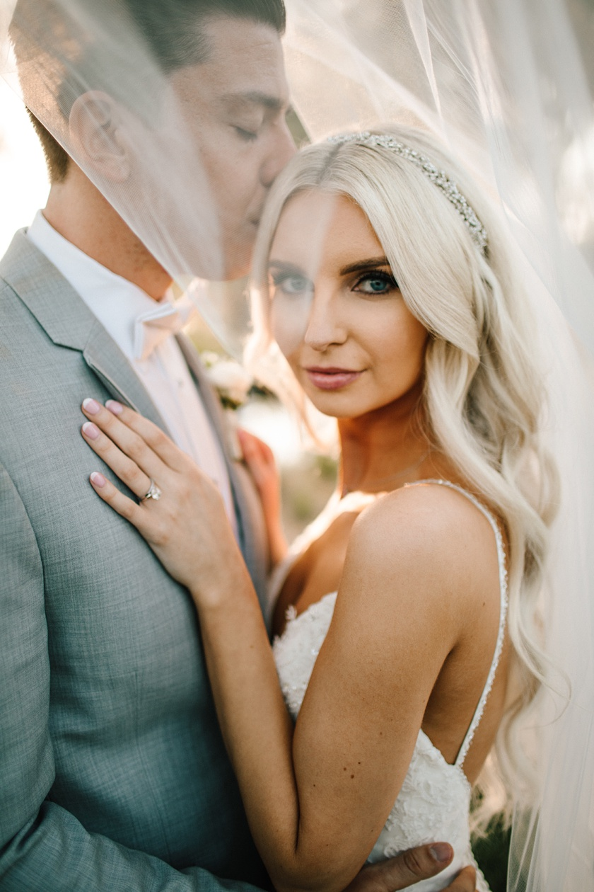 blonde bride with groom under veil at Galway Downs Temecula wedding