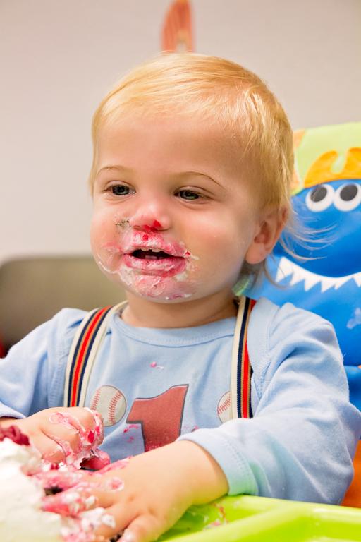 Enjoying his cake smash