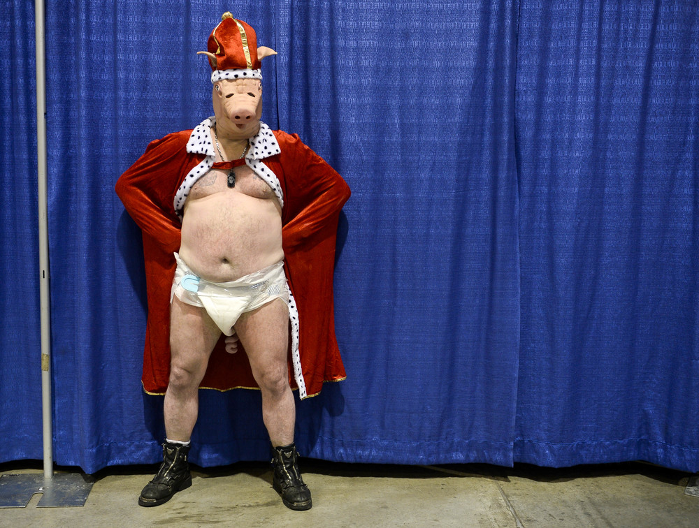 John Marshoff, 45, poses for pictures at the 1st Annual BaconFest. Marshoff was selected as bacon king at the bacon king and queen contest held at the Harley Davidson in St. Joe, Mo., on Sept. 20. His talent was juggling oranges.