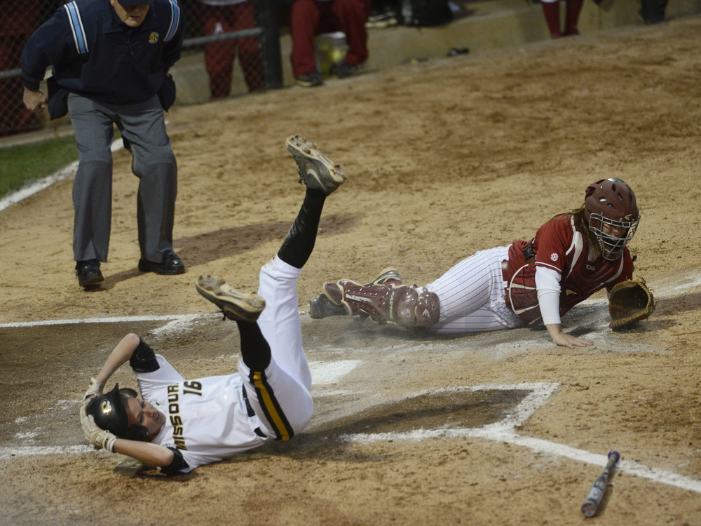 Missouri junior infielder Corrin Genovese safely slides home past Alabama senior catcher Molly Fichtner during the game against Alabama at University Field on Thursday, May 1, 2014. The tigers won 8-6.
