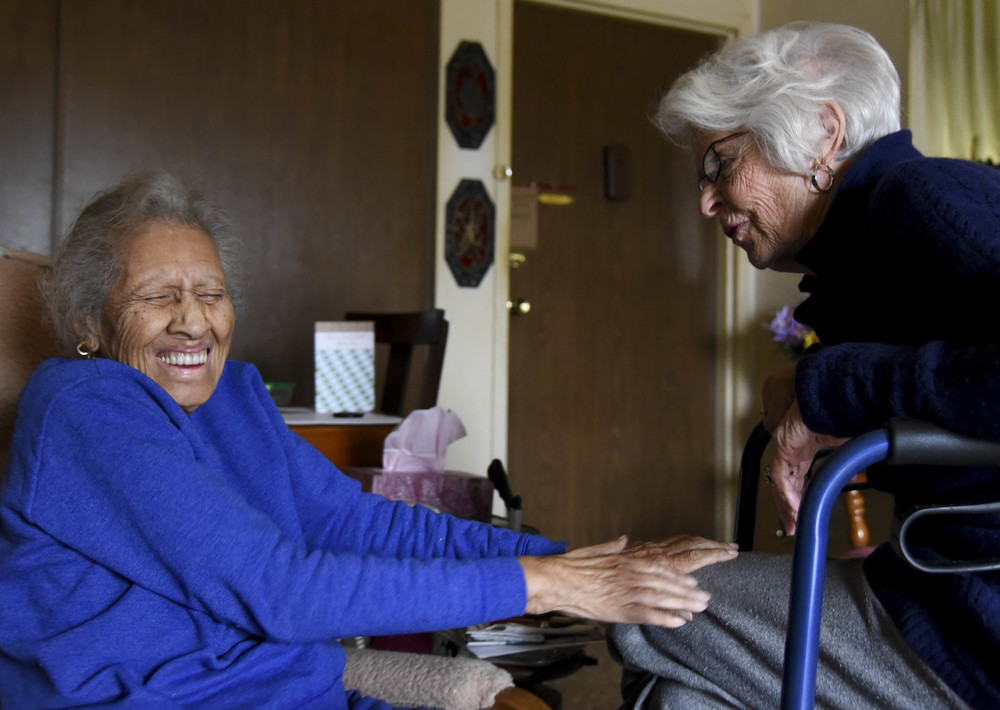 From left, RuBenia White, 96, welcomes a visit from her longtime friend Martha Garnett, 86, at White's apartment on November 15, 2014. White fell and broke her hip in mid-October and underwent a total hip replacement. She was in the hospital for a month. White hadn't seen Garnett since before she went to the hospital.