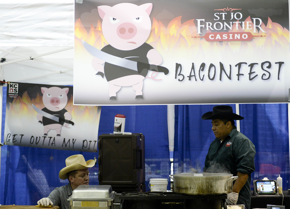 "Brice Dewsbury, 28, and Jose Reys, 41, from the Frontier Casino prepare their bacon chicken fajitas for the recipe contest. ""We were just sitting around drinking beer when I thought, 'Why not make bacon fajitas?'"" Dewsbury said."