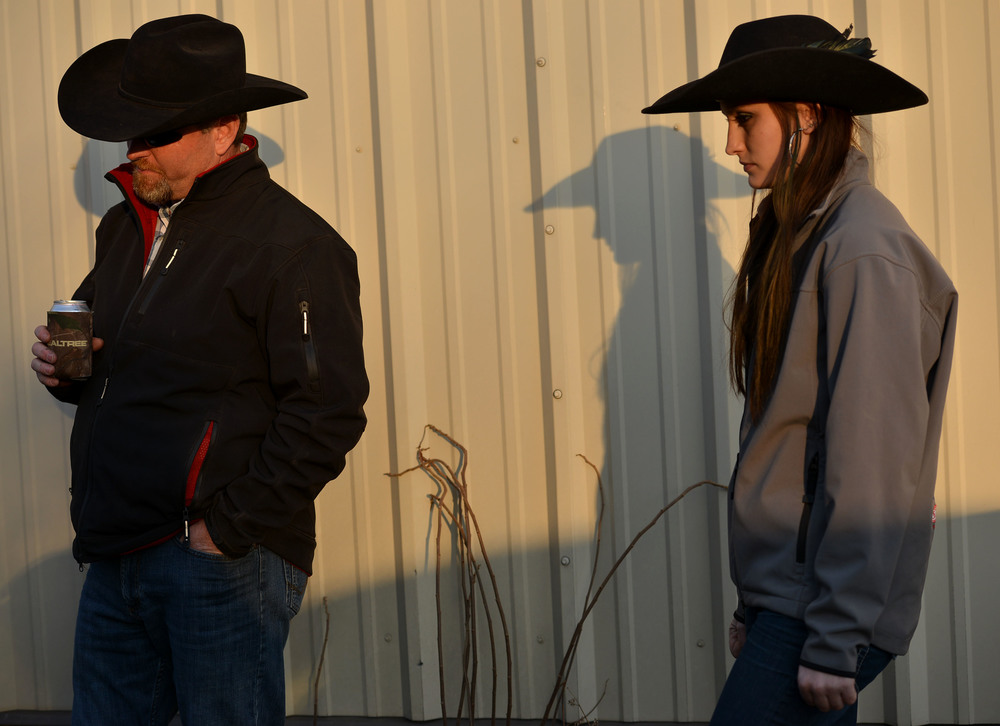 "Amee stands with her dad, Bob Riley, shortly before a barrel racing competition in Eldon, Mo. Bob likes to keep Amee company at rodeos, which they attend almost every weekend in the summertime. ""He doesn't like me to go by myself,"" she says."
