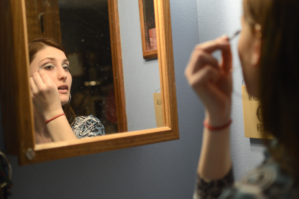"Amee puts on mascara before leaving for the rodeo. ""You never know who you're gonna see,"" Amee says. She likes to attend rodeos with her friends, many of whom also barrel race."