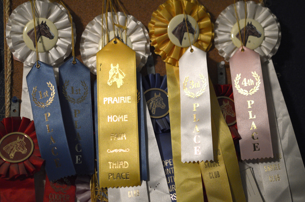 Several ribbons from barrel racing hang from Amee's bedroom wall. She was crowned the Missouri High School Rodeo Queen for the 2011-2012 season.