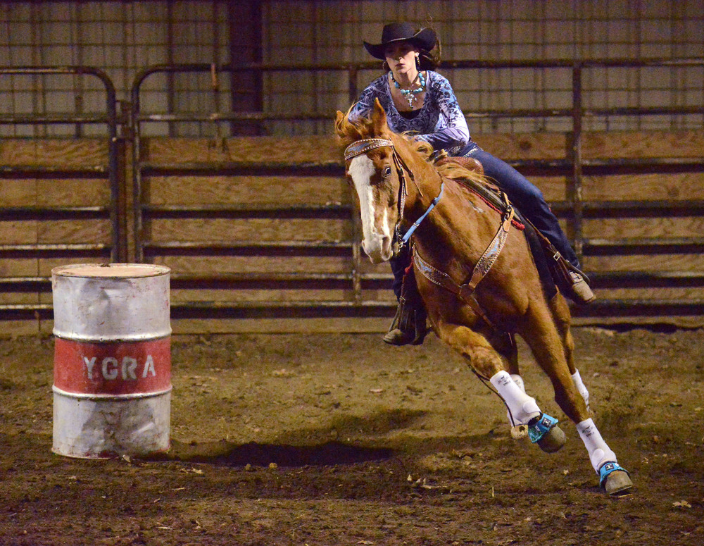 "Amee Riley races on her horse Banjo at a rodeo in Eldon, Mo. Amee won first place and a belt buckle at the rodeo for having the most points in her age division. ""I don't really have spare time,"" she says. ""I just ride my horses."""