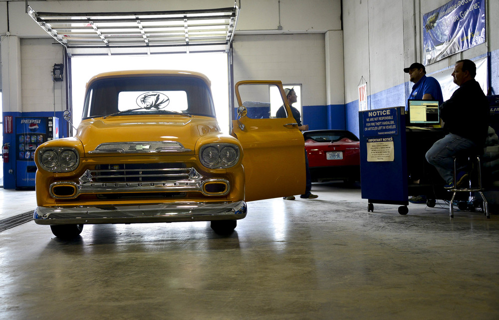 """Teel takes a 46' Chevy Mizzou-themed pickup to get inspected. The project took eight months and was for Roger Gregory, a local farmer and his son, Kurtis Gregory, a retired MU football player. """"She purrs like a little kitten."""" Teel said."""