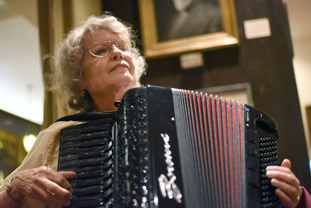 Bobbie Edler plays the accordion during squeezebox night at the Ratskeller Restaurant on August 18, 2015.