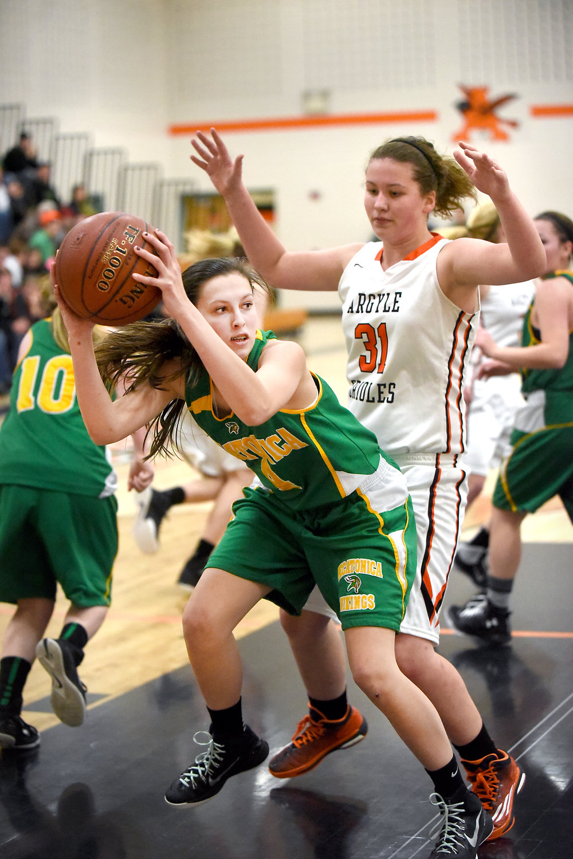 Pecatonica sophomore Grace Keast rebounds against Argyle freshman Natalie Allison at Argyle High School on Jan. 12, 2016.