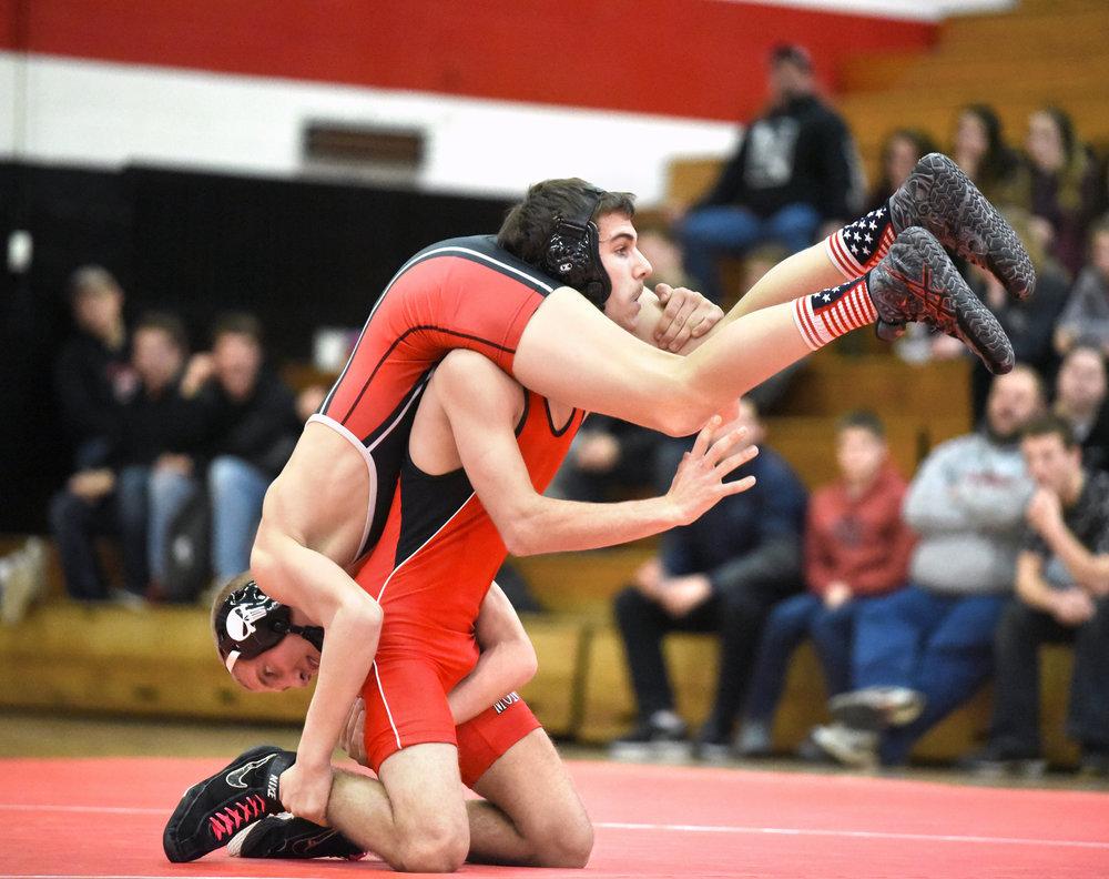 Monroe senior David Andrews wrestles Fort Atkinson senior Brendan Kind Jan. 13, 2017. Kind pinned Andrews in 3 minutes, 40 seconds at 126 pounds.
