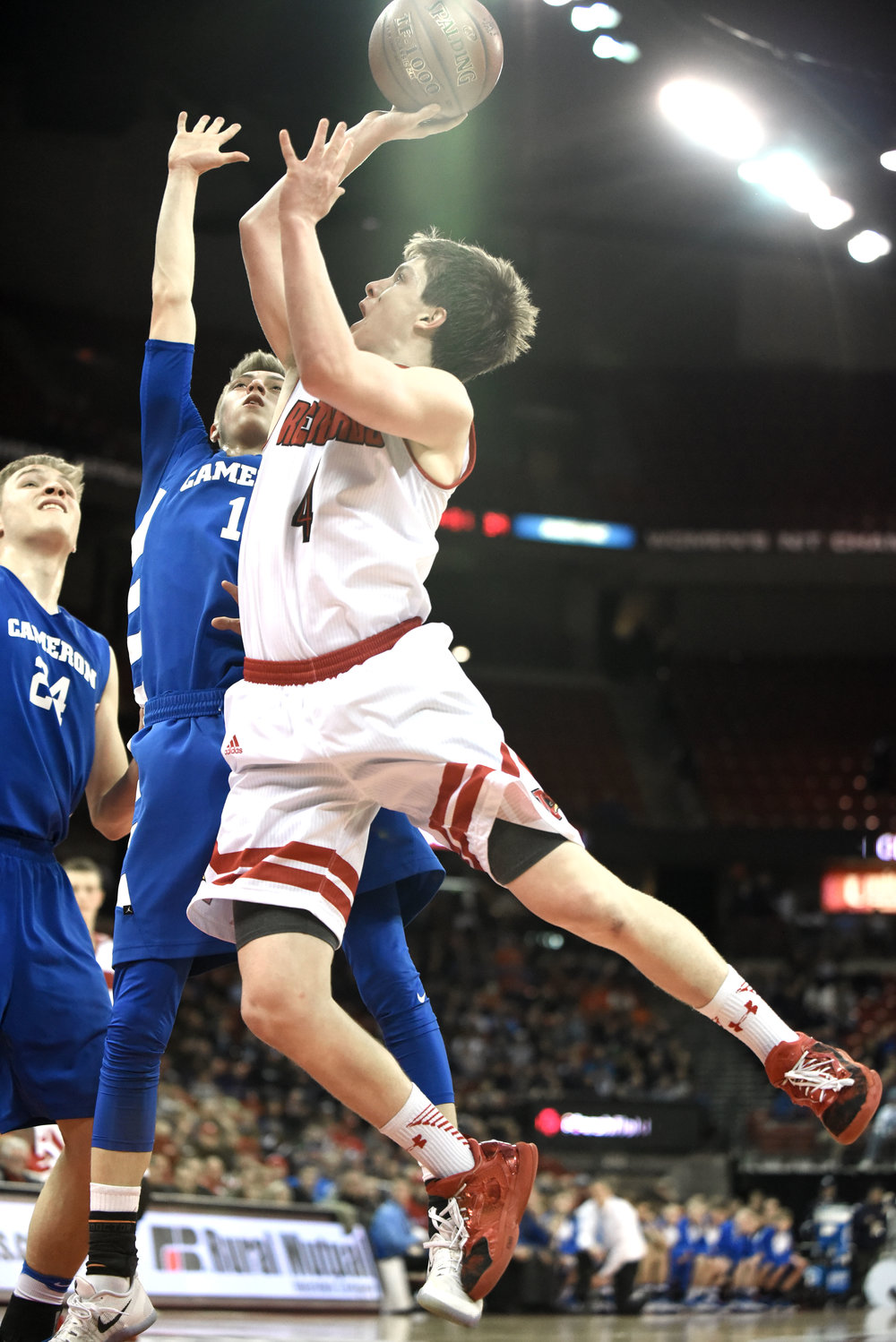 Darlington senior Ryan Glendenning scores against Cameron during their Division 4 State Semifinal game at the Kohl Center March 16, 2017.