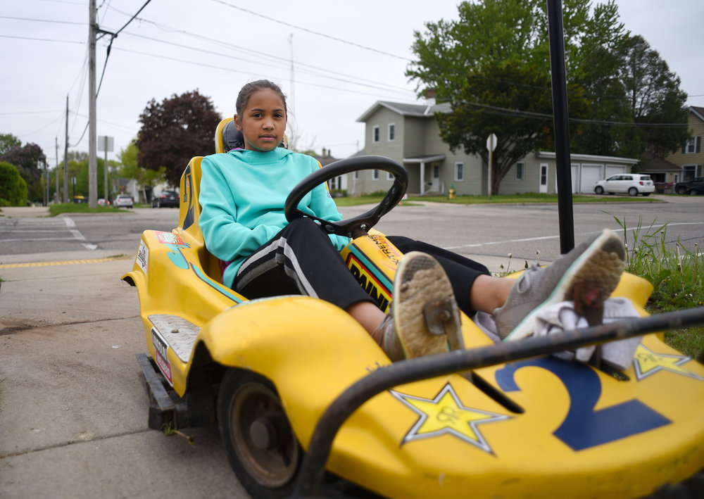 Alexus Schultz, 10, rides her go-kart in front of her house after school May 9, 2017. Schultz has had her go-kart for about a year, after getting it last year for her birthday. Schultz had always wanted a go-kart and tries to rides it almost every day.