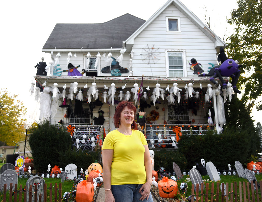 Christy Montgomery stands in front of her elaborately decorated house for Halloween in Monroe Oct. 28, 2016. Montgomery adds more decorations every year.