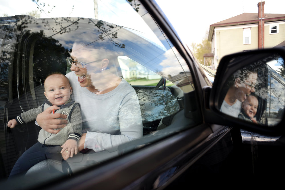 Ashley Geisler and her six-month-old son, Isaac, sit in her Jeep where she gave birth in the backseat to Isaac in November 2015. Geisler plans to give her son the Jeep when he is old enough to drive.