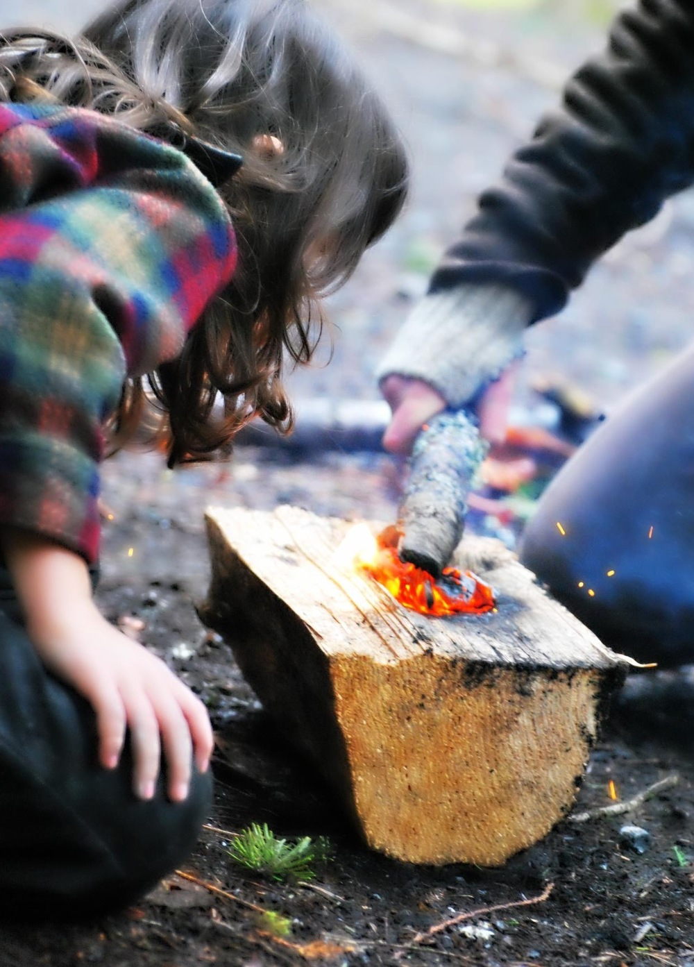 In our rainy Seattle climate we make fires many days to keep warm. Our students love to interact with fire in a safe way.