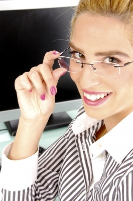 Smiling Businesswoman Holding Specs