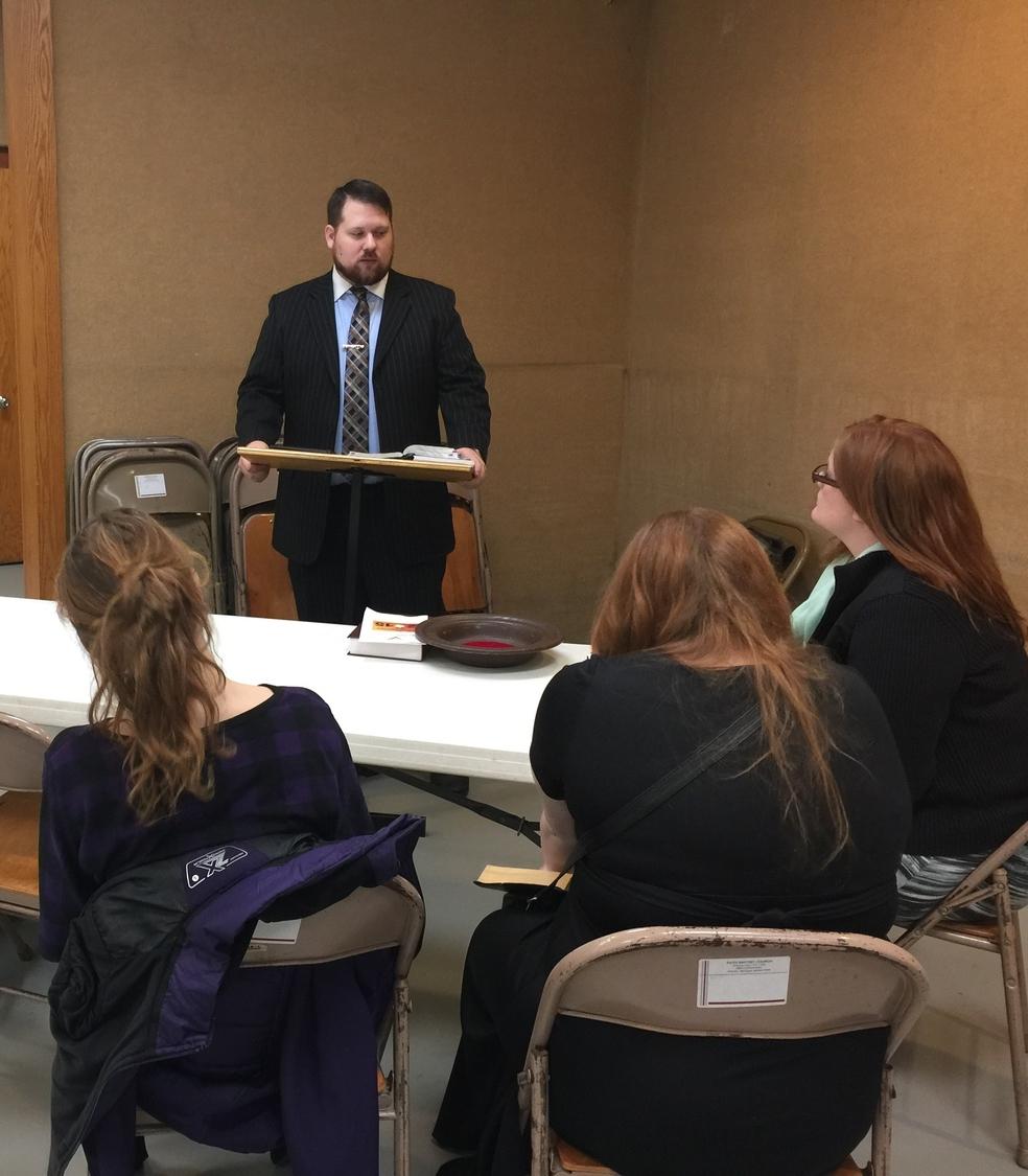 Allan Bladorn teaches Sunday School to theteens.