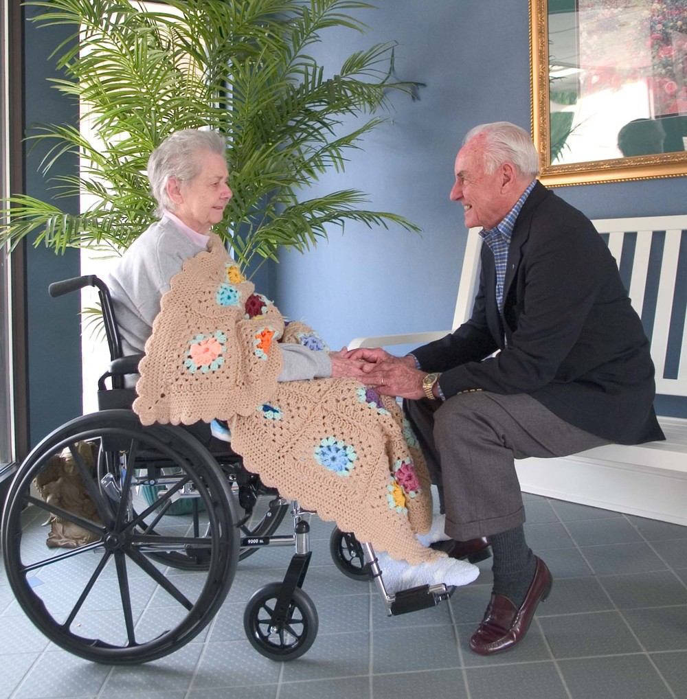 John Sidey visiting with hospice patient