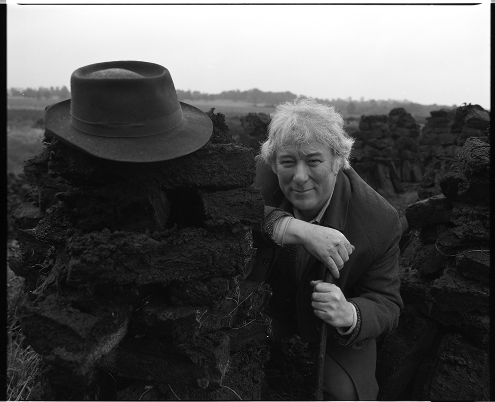 Seamus Heaney at a turf bog in Bellaghy, 1986. Photo by Bobbie Hanvey.