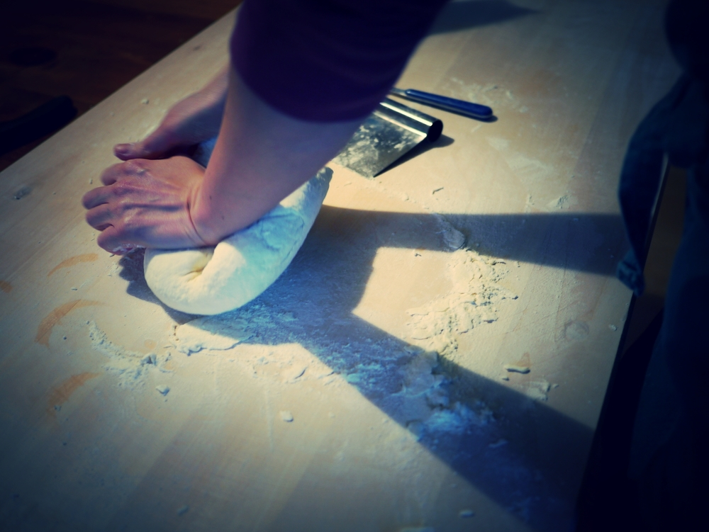 Francesca T. kneading the dough.