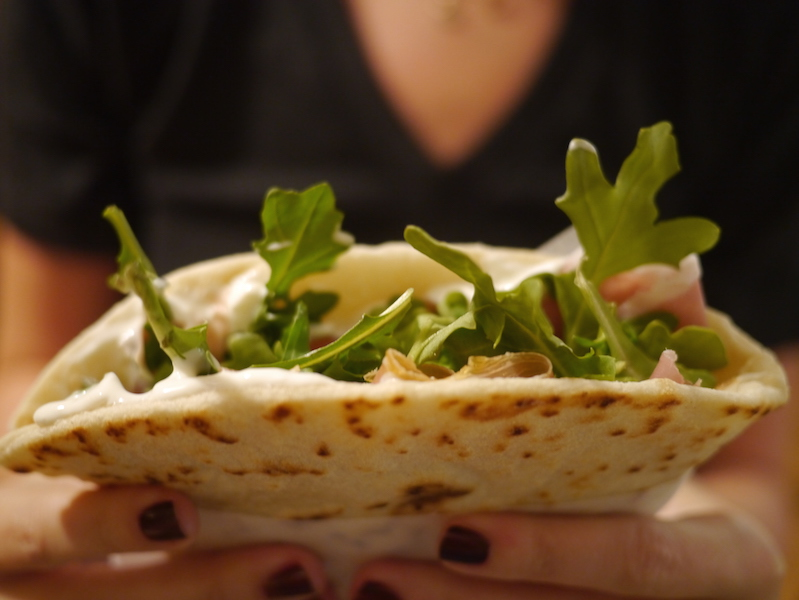 Our favorite piadina we enjoyed while in Italy is slathered with tangy, creamy squacquerone and topped with sheer, thin slices of prosciutto & a handful of peppery arugula.