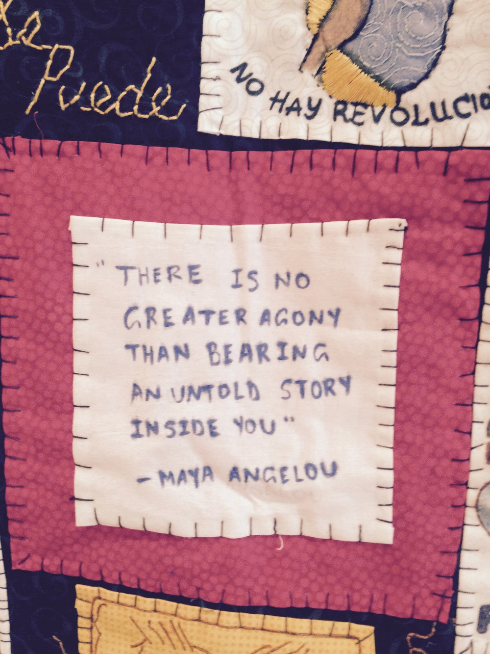 A close-up of a quilt in the CoV4 exhibition room.