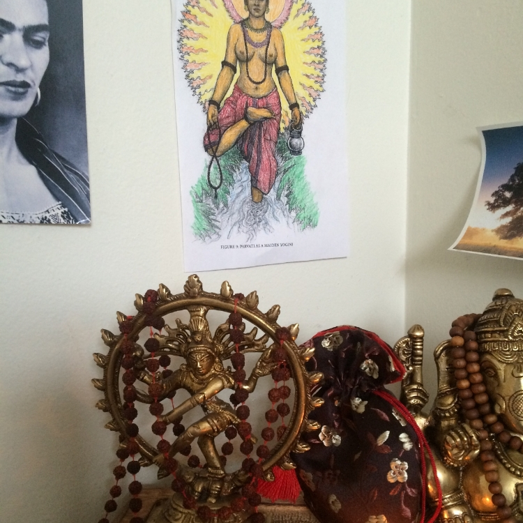 A close-up of my altar at home. Frida Kahlo, an illustration of Parvati that I colored, and two deities I work with regularly.