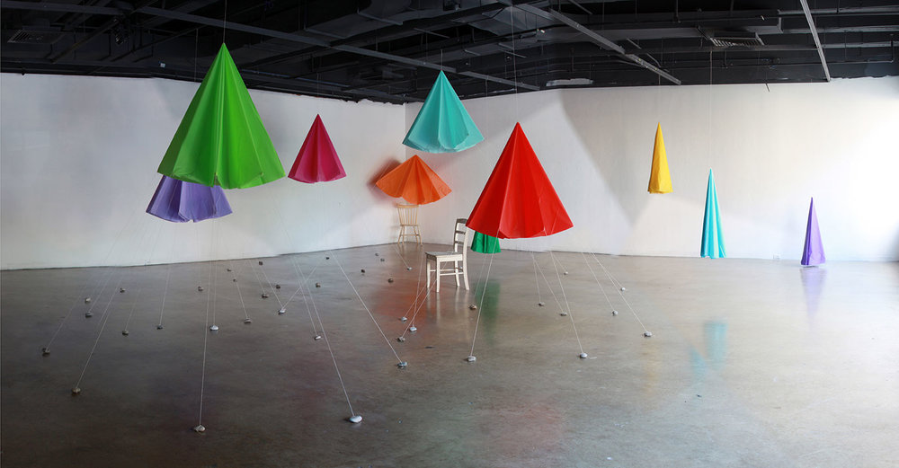 Canopy Room (daytime), 2014. One day installation. Plastic party tablecloths, string, found stones.