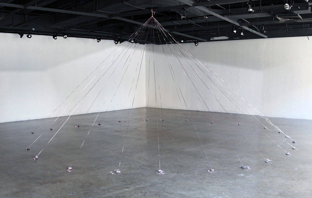 Open Canopy, 2014. One hour installation. Pink ribbon, found stones.