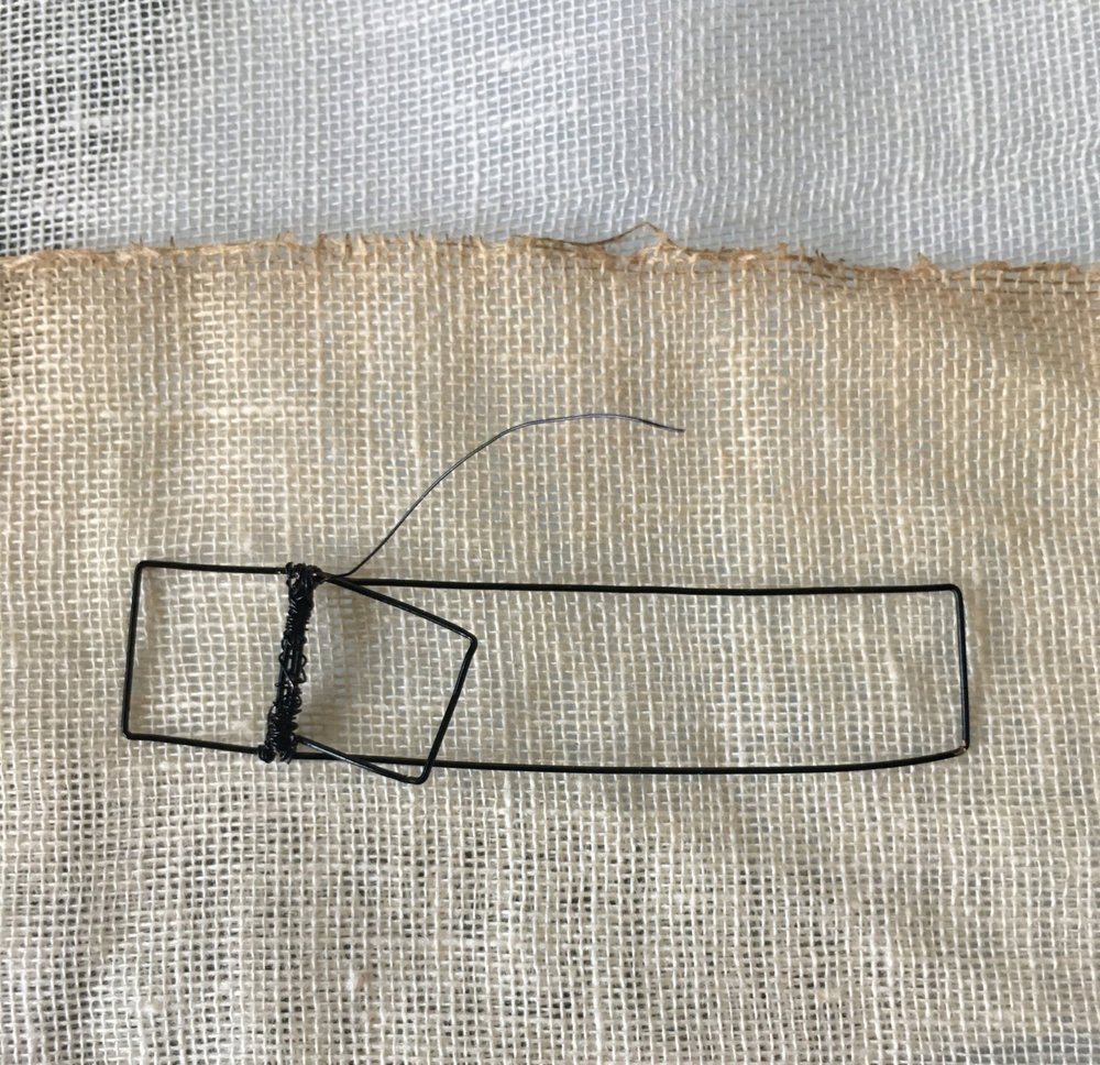 "Detail of strap from ""Plaster Armor No. 1"" formed by hand using annealed steel wire (gauges 28 + 34) and coffee-stained US Army-regulation gauze circa 1953. - 5/18"