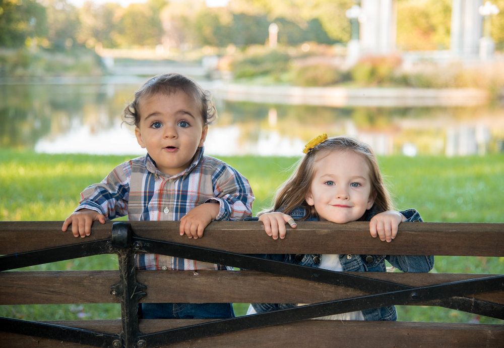 Cute kids looking over a bench in St Louis Missouri