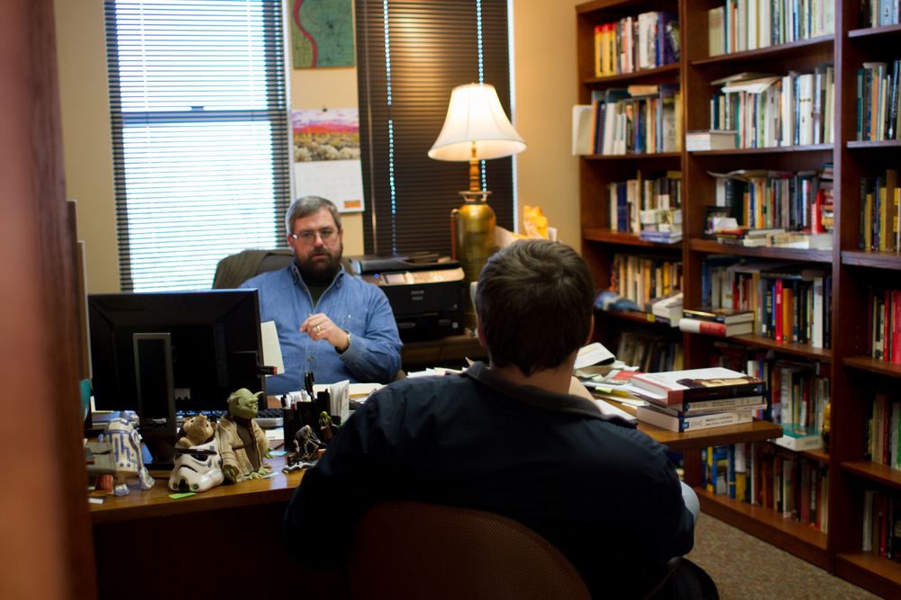 Dr. Follett in his office advising a student, photo courtesy of Abby Whisler