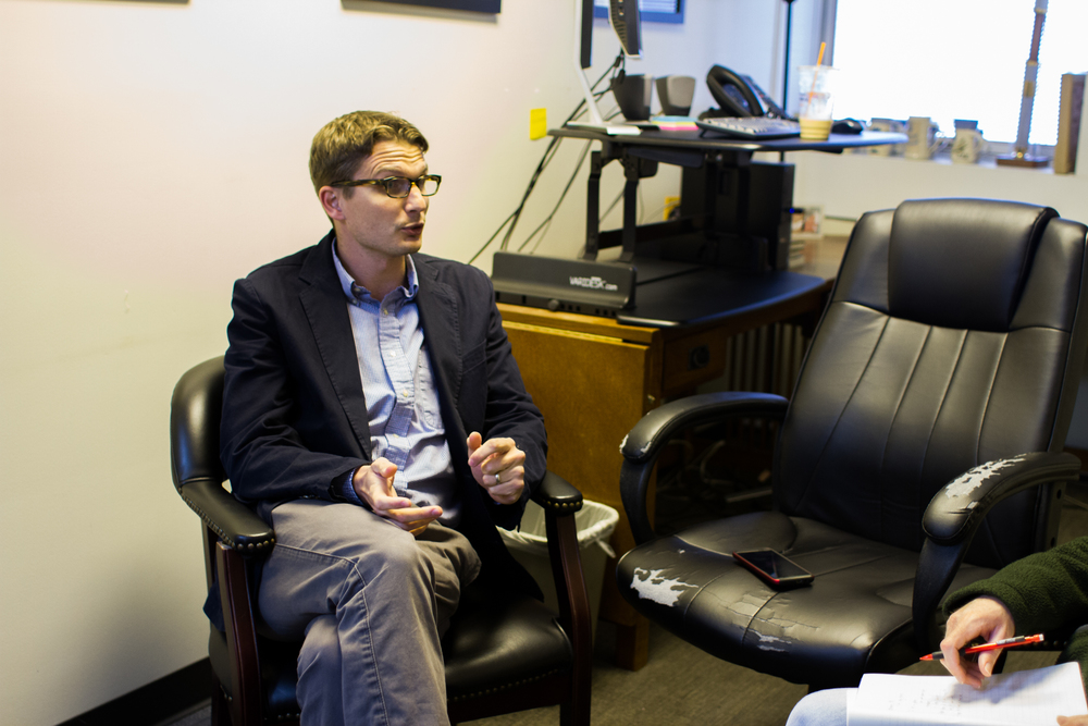 Jonathan Ingraham talks with Garrett Sisson about changes in Residence Life. Photo by Abby Whisler