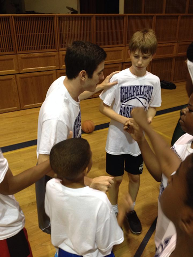 Jake DeLaney working at a summer basketball camp in Ellicott City, Maryland. Photo by Nate Frierson