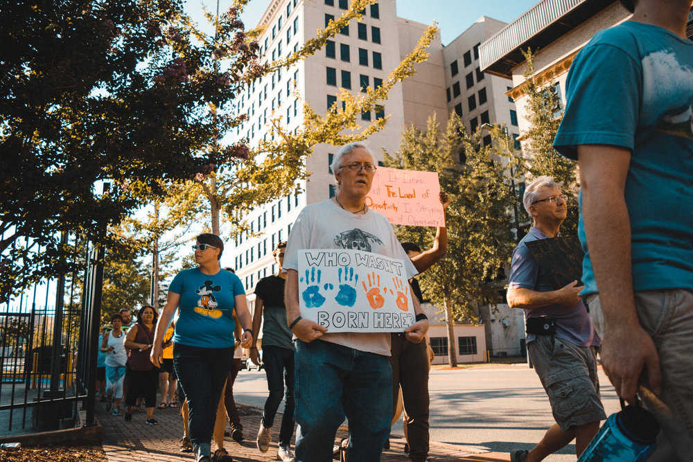 Protestors recently staged a march in downtown Chattanooga in support of DACA. Photo by Peyden Valentine.